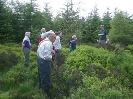HAHS Members inspecting the circular, banked feature at Jingleby Thorn
