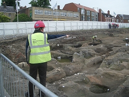 Peter Connolly points out features of the Hungate excavation