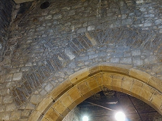 During the installation of a much larger arch in the aisle a strengthening arch was installed in the wall above